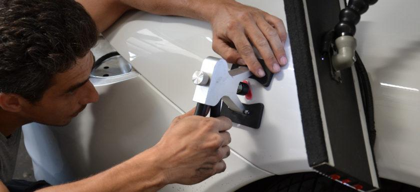 Удаление вмятин на кузове автомобиля без покраски